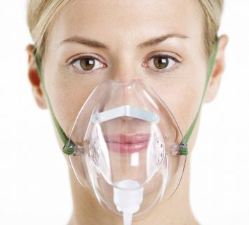Woman Wearing Oxygen Mask